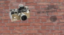 A Camera superimposed on a wall made using aviary